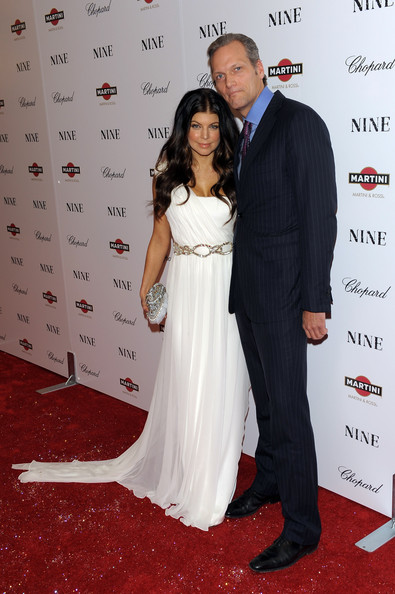 Singer Fergie (L) and President and CEO of Chopard USA Marc Hruschka attend the New York premiere of
