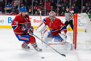 Andrei Markov #79 of the Montreal Canadiens clears the puck away from goaltender Carey Price #31 during the NHL game at the Bell Centre on October 15, 2015 in Montreal, Quebec, Canada.