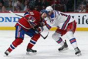Daniel Briere #48 of the Montreal Canadiens is checked by John Moore #17 of the New York Rangers in Game One of the Eastern Conference Final during the 2014 Stanley Cup Playoffs at the Bell Centre on May 17, 2014 in Montreal, Canada. The Rangers defeated the Canadiens 7-2.