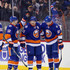 Josh Bailey Brock Nelson Photos - (l-r) Josh Bailey #12, Kyle Okposo #21 and Brock Nelson #29 of the New York Islanders celebrate Okposo's empty net goal against the New York Rangers at the Barclays Center on January 14, 2016 in the Brooklyn borough of New York City. The Islanders defeated the Rangers 3-1. - New York Rangers v New York Islanders