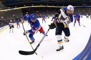 Alexander Steen #20 of the St. Louis Blues passes thepouck against Marc Staal #18 of the New York Rangers at the Scottrade Center on March 17, 2018 in St. Louis, Missouri.