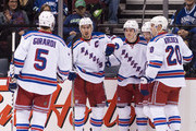 Ryan McDonagh #27 of the New York Rangers celebrates with teammates Dan Girardi #5, Jesper Fast #19, Dominic Moore #28 and Chris Kreider #20 after scoring a goal against the Vancouver Canucks during NHL action at Rogers Arena on December 13, 2014 in Vancouver, British Columbia, Canada.