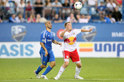 Jan Gunnar Solli #8 of the New York Red Bulls heads the ball in front of Marco Di Vaio #9 of the Montreal Impact at the Saputo Stadium on July 28, 2012 in Montreal, Quebec, Canada.  The Impact defeated the Red Bulls 3-1.
