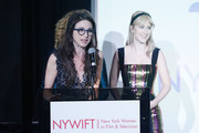 "(L-R)  Marin Hinkle and Rachel Brosnahan on stage at the New York Women in Film and Television's ""Designing Women Awards"" at the DGA on June 11, 2019 in New York City."