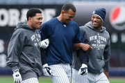 Melky Cabrera #53, Alex Rodriguez #13 and Robinson Cano #24 of the New York Yankees warm up in the outfield during workouts  on October 15, 2009 at Yankee Stadium in the Bronx borough of New York City.