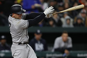 Matt Holliday #17 of the New York Yankees follows through as he hits a two run home run against the Baltimore Orioles during the third inning at Oriole Park at Camden Yards on April 7, 2017 in Baltimore, Maryland.