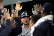 Matt Holliday #17 of the New York Yankees celebrates a third inning home run with teammates in the dugout against the Baltimore Orioles Oriole Park at Camden Yards on May 30, 2017 in Baltimore, Maryland.