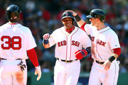 Yoenis Cespedes #52 celebrates with Daniel Nava #29 of the Boston Red Sox after scoring in the second inning against the New York Yankees during a game at Fenway Park on September 27, 2014 in Boston, Massachusetts.