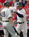 Derek Jeter #2 (R) of the New York Yankees celebrates with teammate Johnny Damon #18 after hitting a home run during the first inning off Jered Weaver #36 (Not Shown) of the Los Angeles Angels of Anaheim in Game Three of the ALCS during the 2009 MLB Playoffs at Angel Stadium on October 19, 2009 in Anaheim, California.