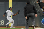 Andrew McCutchen #26 of the New York Yankees catches the ball hit by Johnny Field #51 of the Minnesota Twins in right field as first base umpire James Hoye #92 looks on during the second inning of the game on September 10, 2018 at Target Field in Minneapolis, Minnesota.