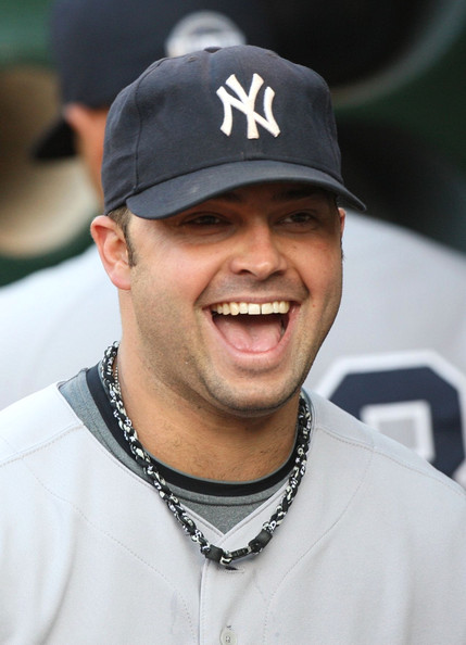 Nick Swisher Nick Swisher #33 of the New York Yankees smiles in the dugout prior to the Major League Baseball game against the Oakland Athletics at the Oakland Coliseum on August 17, 2009 in Oakland, California.