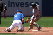 Rob Refsnyder #38 of the New York Yankees steals second base in the third inning during MLB game action as Troy Tulowitzki #2 of the Toronto Blue Jays attempts to tag him out at Rogers Centre on June 3, 2017 in Toronto, Canada.