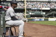 Andrew McCutchen #26 of the New York Yankees sits on a stool on the warning track waiting a play to be reviewed before his at-bat during the second inning of a game at Safeco Field on September 9, 2018 in Seattle, Washington. The Mariners won 3-2.