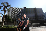 Ben Smith, Anton Lienert-Brown and Ryan Crotty walk back to their bus after a New Zealand All Blacks gym session on October 22, 2018 in Tokyo, Japan.
