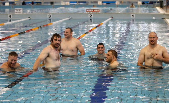 (L-R) Brad Thorn, Andrew Hore, Tony Woodcock, Corey Flynn, Owen Franks and Ben Franks relax during a New Zealand All Blacks IRB Rugby World Cup 2011 recovery session at the Waterworld Aquatic Centre on September 11, 2011 in Hamilton, New Zealand.