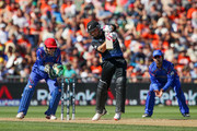 Brendon McCullum of New Zealand bats while Afsar Zazai (L) and Asghar Stanikzai of Afghanistan look on during the 2015 ICC Cricket World Cup match between New Zealand and Afghanistan at McLean Park on March 8, 2015 in Napier, New Zealand.