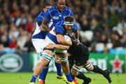 PJ Van Lill of Namibia is tackled by Sam Cane of the New Zealand All Blacks during the 2015 Rugby World Cup Pool C match between New Zealand and Namibia at the Olympic Stadium on September 24, 2015 in London, United Kingdom.