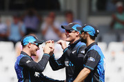 Martin Guptill of the Black Caps celebrates after making a catch to dismiss Ahmed Shehzad of Pakistan with Brendon McCullum and Grant Elliott of the Black Caps during the One Day International match between New Zealand and Pakistan at Eden Park on January 31, 2016 in Auckland, New Zealand.