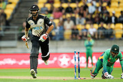 Grant Elliott of New Zealand is run out by Sarfraz Ahmed of Pakistan during the Twenty20 International match between New Zealand and Pakistan at Westpac Stadium on January 22, 2016 in Wellington, New Zealand.