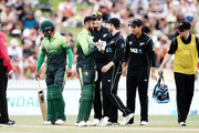 Kane Williamson of New Zealand checks on Shoaib Malik of Pakistan's well being after being hit on the head by a ball during game four of the One Day International Series between New Zealand and Pakistan at Seddon Park on January 16, 2018 in Hamilton, New Zealand.
