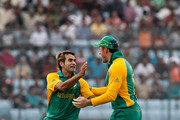 Imran Tahir (L) of South Africa celebrates with Graeme Smith after claiming the wicket of Ross Taylor of New Zealand who was caught during 2011 ICC World Cup Quarter-Final match between New Zealand and South Africa at Shere-e-Bangla National Stadium on March 25, 2011 in Dhaka, Bangladesh.