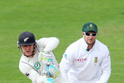 Mark Boucher of South Africa looks on while Brendon McCullum of New Zealand bats during day four of the Third Test match between New Zealand and South Africa at Basin Reserve on March 26, 2012 in Wellington, New Zealand.