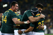 Cheslin Kolbe of South Africa celebrates with Damian de Allende and Jesse Kriel after scoring a try during The Rugby Championship match between the New Zealand All Blacks and the South Africa Springboks at Westpac Stadium on September 15, 2018 in Wellington, New Zealand.