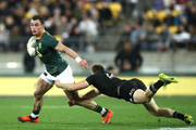 Jesse Kriel of South Africa is tackled by Ben Smith of the All Blacks during The Rugby Championship match between the New Zealand All Blacks and the South Africa Springboks at Westpac Stadium on September 15, 2018 in Wellington, New Zealand.
