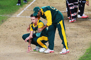 Dale Steyn of South Africa is comforted by Imran Tahir of South Africa after losing the 2015 Cricket World Cup Semi Final match between New Zealand and South Africa at Eden Park on March 24, 2015 in Auckland, New Zealand.