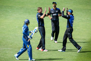 Tim Southee, Grant Elliott and Martin Guptill of New Zealand celebrate after taking the wicket of Tillakaratne Dilshan of Sri Lanka during the One Day International match between New Zealand and Sri Lanka at Westpac Stadium on January 29, 2015 in Wellington, New Zealand.