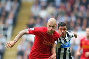 Martin Skertel of Liverpool and Hatem Ben Arfa of Newcastle United battle for the ball during the Barclays Premier League match between Newcastle United and Liverpool at St James' Park on October 19, 2013 in Newcastle upon Tyne, England.