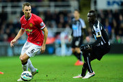 Manchester United player Jonny Evans (l) in action as Papiss Cisse of Newcastle looks on during the Barclays Premier League match between Newcastle United and Manchester United at St James' Park on March 4, 2015 in Newcastle upon Tyne, England.