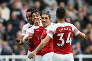 Mesut Ozil of Arsenal celebrates after scoring his team's second goal with team mates during the Premier League match between Newcastle United and Arsenal FC at St. James Park on September 15, 2018 in Newcastle upon Tyne, United Kingdom.