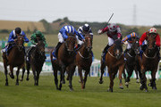 Paul Hanagan riding Muhaarar (3L, blue/white cap) wins The Darley July Cup from Tropics (C, spotted cap) at Newmarket racecourse on July 11, 2015 in Newmarket, England.