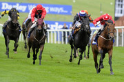 Paul Hanagan riding Mayson (R) win The Darley July Cup at Newmarket racecourse on July 14, 2012 in Newmarket, England.