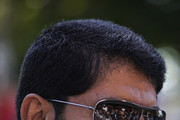 Trainer Saeed bin Suroor chats with Sheikh Mohammed bin Rashid Al Maktoum who is reflected in his sunglasses at Newmarket Racecourse on July 12, 2018 in Newmarket, United Kingdom.