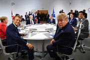 France's President Emmanuel Macron and US President Donald Trump pose for the media as they meet for the first working session of the G7 Summit on August 25, 2019 in Biarritz, France. The French southwestern seaside resort of Biarritz is hosting the 45th G7 summit from August 24 to 26. High on the agenda will be the climate emergency, the US-China trade war, Britain's departure from the EU, and emergency talks on the Amazon wildfire crisis.