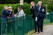 British Prime Minister Theresa May and her husband Philip talk to locals as they arrive to cast their votes at a polling station in the local council elections on May 2, 2019 in Sonning, England. Voters are heading to the polls today for council and mayoral elections across England and Northern Ireland.