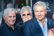 Klaus Wowereit (r), his partner Joern Kubicki (L) and Markus Schaechter (M) attend the opening night of the Nibelungen festival on July 31, 2015 in Worms, Germany.