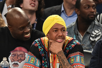 Nick Cannon Celebrities Attend The 66th NBA All-Star Game