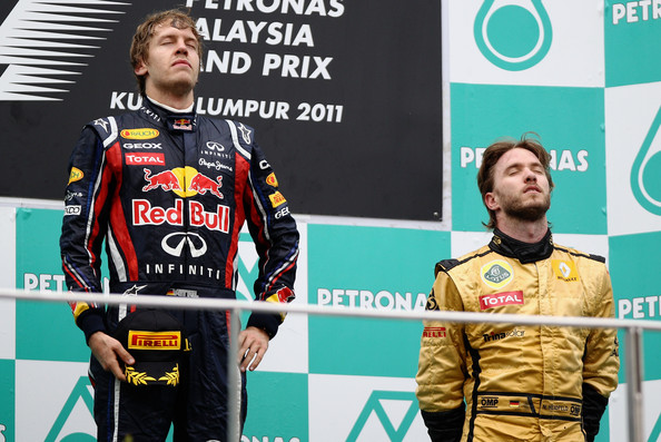 Nick Heidfeld Race winner Sebastian Vettel (L) of Germany and Red Bull Racing celebrates with third placed Nick Heidfeld (R) of Germany and Renault on the podium after the Malaysian Formula One Grand Prix at the Sepang Circuit on April 10, 2011 in Kuala Lumpur, Malaysia.