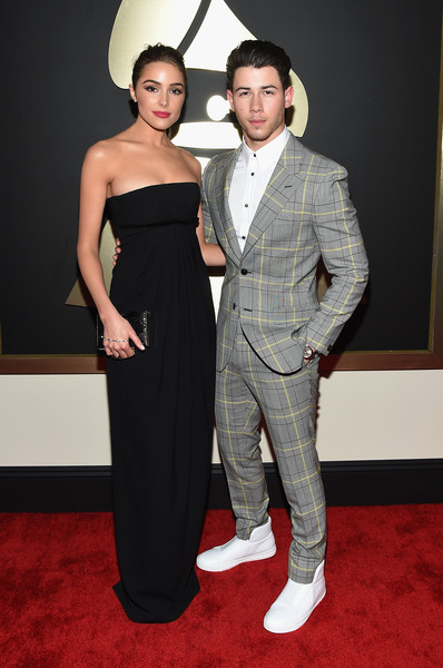 The 57th Annual GRAMMY Awards - Red Carpet [red carpet,red carpet,carpet,clothing,suit,dress,fashion,formal wear,flooring,event,premiere,nick jonas,actor,olivia culpo,california,los angeles,staples center,57th annual grammy awards,the 57th annual grammy awards]