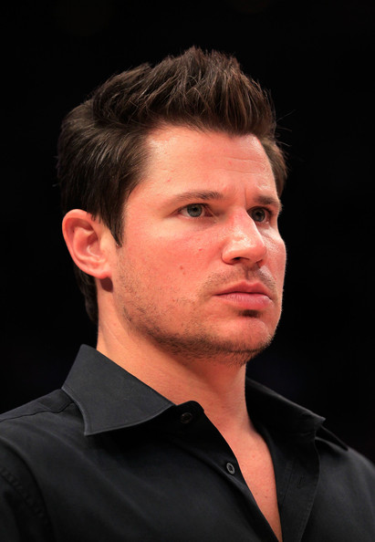 Nick Lachey Singer Nick Lachey looks on during the game between the Connecticut Huskies and the Syracuse Orange during the semifinals of the 2011 Big East Men's Basketball Tournament presented by American Eagle Outfitters at Madison Square Garden on March 11, 2011 in New York City.