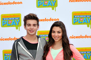 Actors  (L-R) Jack Griffo and  Kira Kosarin attend Nickelodeon's 11th Annual Worldwide Day of Play at Prospect Park on September 20, 2014 in New York City.