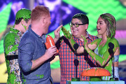 (L-R) Actors Nolan Gould, Jesse Tyler Ferguson, Rico Rodriguez and Sarah Hyland get slimed as they accept award for Favorite Family TV Show for Modern Family onstage during Nickelodeon's 28th Annual Kids' Choice Awards held at The Forum on March 28, 2015 in Inglewood, California.