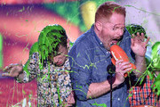 (L-R) Actors Nolan Gould, Jesse Tyler Ferguson and Rico Rodriguez get slimed as they accept award for Favorite Family TV Show for Modern Family onstage during Nickelodeon's 28th Annual Kids' Choice Awards held at The Forum on March 28, 2015 in Inglewood, California.