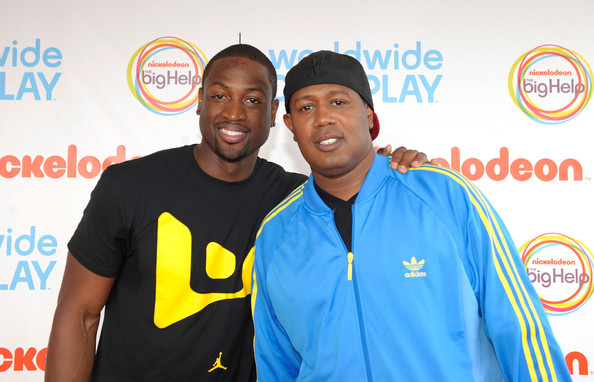 NBA player Dwyane Wade (L) and Master P celebrate Nickelodeon's largest ever Worldwide Day of Play at the Ellipse on September 24, 2011 in Washington, DC.