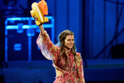 Honoree Danica Patrick is 'slimed' while accepting the Legend Award onstage during the Nickelodeon Kids' Choice Sports 2018 at Barker Hangar on July 19, 2018 in Santa Monica, California.