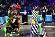 Laurie Hernandez, P. K. Subban, David Dobrik, Rob Gronkowski, Trae Young, host Michael Strahan, Shaun White, Lindsey Vonn, and Kel Mitchell react after being slimed onstage during onstage during Nickelodeon Kids' Choice Sports 2019 at Barker Hangar on July 11, 2019 in Santa Monica, California.