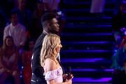 Zion Williamson and Mikaela Shiffrin speak onstage during Nickelodeon Kids' Choice Sports 2019 at Barker Hangar on July 11, 2019 in Santa Monica, California.